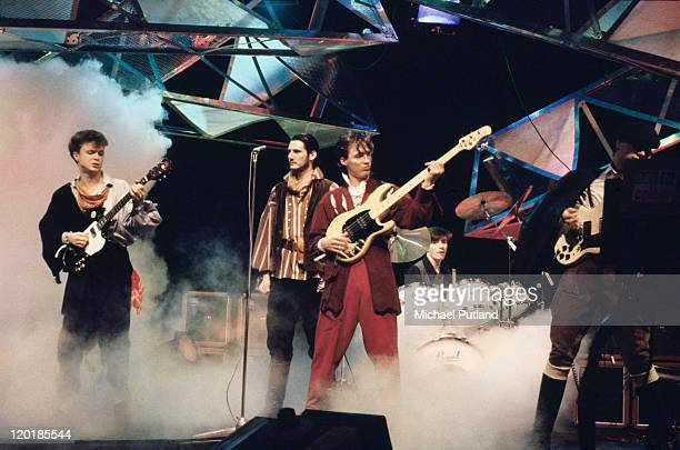 English pop group Spandau Ballet performing on stage, circa 1983. Left to right: Gary Kemp, Tony Hadley, Martin Kemp, John Keeble and Steve Norman.