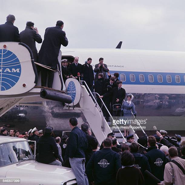 English pop group The Beatles arrive at Kennedy airport in New York for their first visit to the United States on 7th February 1964 On the steps to...