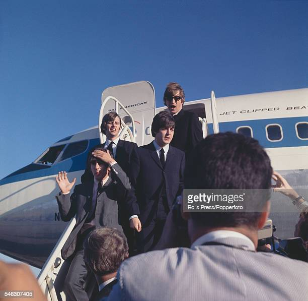 English pop group The Beatles arrive at San Francisco International airport to begin their 25date American tour on 18th August 1964 On the steps to...