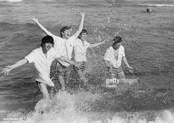 English pop group The Beatles frolicking in the surf at Miami Beach Florida February 1964 Left to right John Lennon Paul McCartney George Harrison...