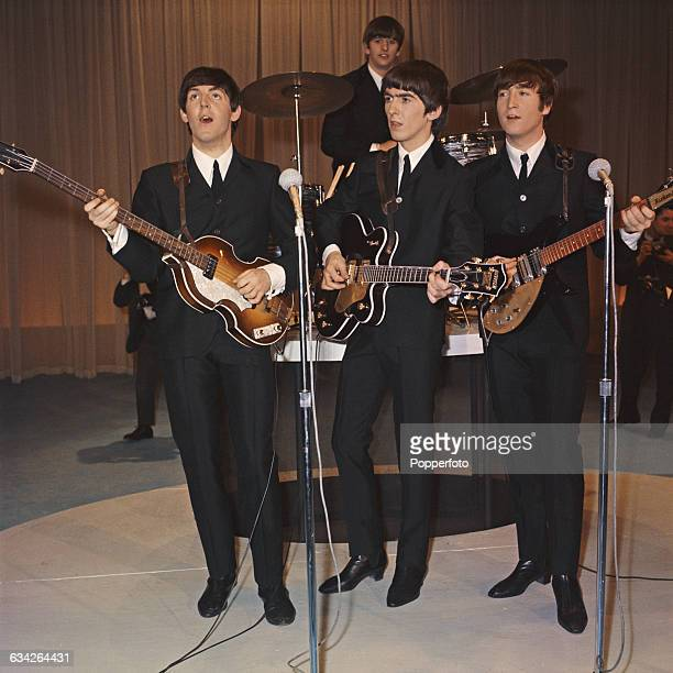 English pop group The Beatles, from left to right, Paul McCartney, Ringo Starr, George Harrison and John Lennon pose with their instruments as they...