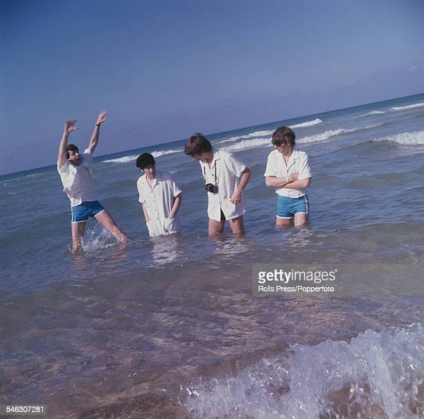 English pop group The Beatles joke and paddle in the sea at Miami Beach in Florida during a break from recording a performance for the Ed Sullivan...