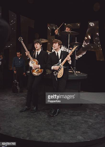 English pop group The Beatles pictured during rehearsals the day before the band's first appearance on The Ed Sullivan Show at CBS's Studio 50 in New...