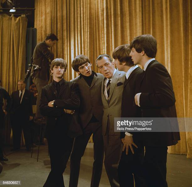 English pop group The Beatles pictured with American television host Ed Sullivan during a recording session for The Ed Sullivan Show in New York on...