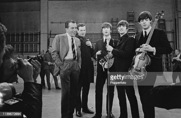 English pop group The Beatles pictured with host Ed Sullivan on the day before the band's performance on The Ed Sullivan Show at CBS's Studio 50 in...