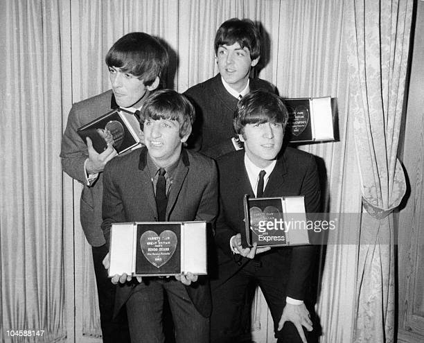 English pop group The Beatles receiving awards from the Variety Club of Great Britain 1963 Back row George Harrison Paul McCartney front row Ringo...