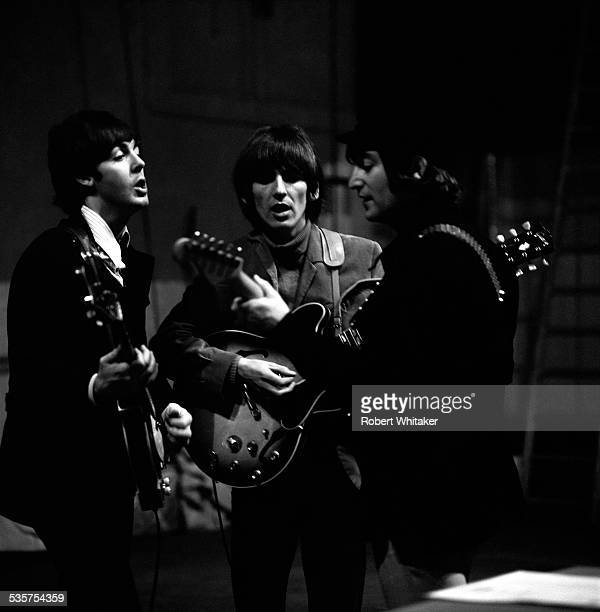 English pop group The Beatles Rehearsing at the Donmar Warehouse theatre London 1964 Left to right Paul McCartney George Harrison and John Lennon