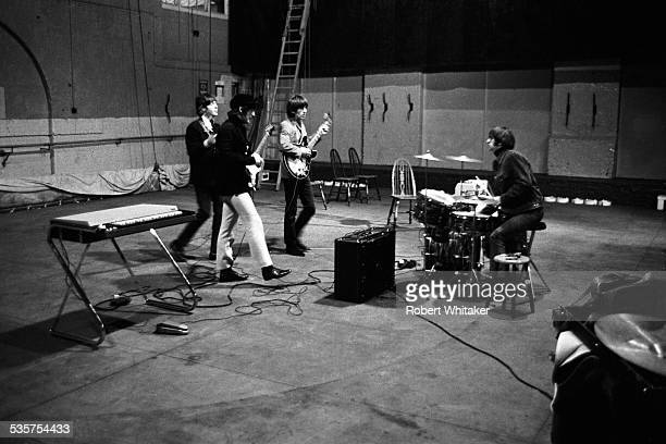 English pop group The Beatles Rehearsing at the Donmar Warehouse theatre London 1964 Left to right Paul McCartney John Lennon George Harrison and...