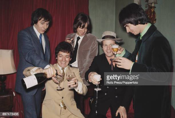 English pop group The Hollies pictured celebrating with champagne and new member Terry Sylvester in London on 16th January 1969 The group are from...