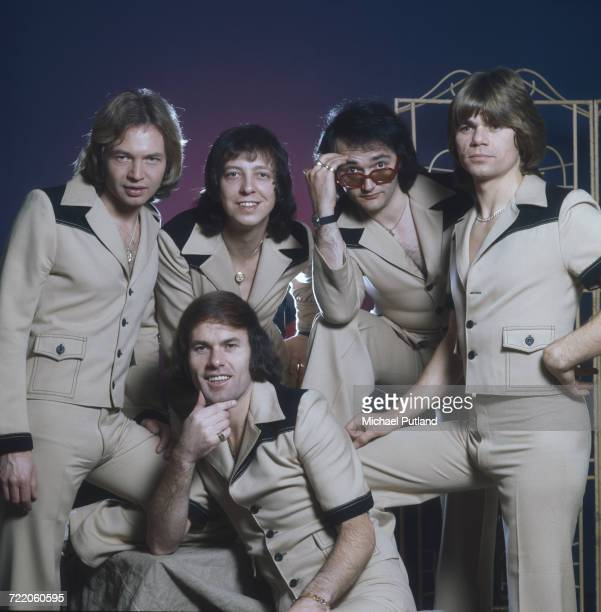 English pop group The Rubettes posed in matching suits 23rd December 1975 From left to right guitarist Alan Williams bassist Mick Clarke keyboard...
