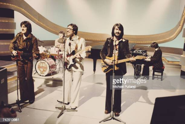 English pop group The Shadows performing on a BBC TV television show in London in 1975 Left to right guitarist Bruce Welch drummer Brian Bennett lead...