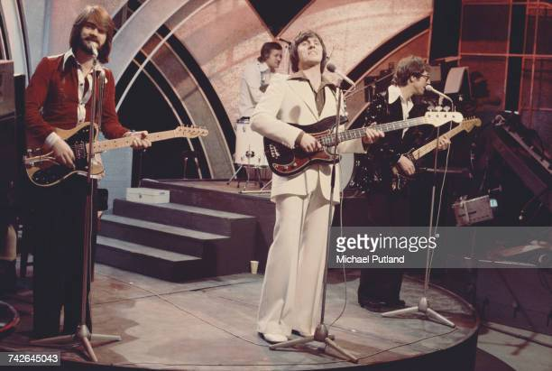 English pop group The Shadows performing on the BBC TV music show 'Top Of The Pops' in London on 27th March 1975 Left to right rhythm guitarist John...
