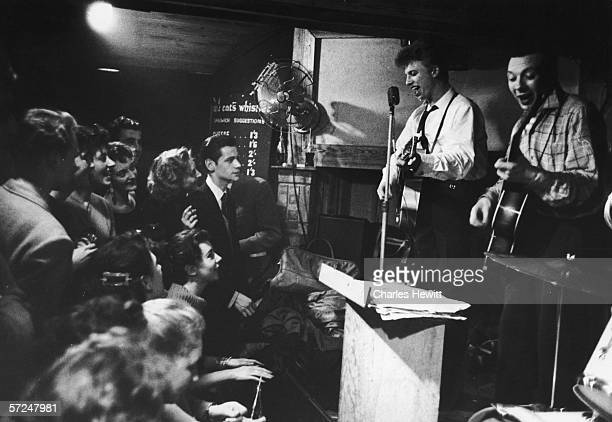 English pop idol Tommy Steele performs at the Cat's Whisker with Leon Bell and his rock 'n' roll band, 4th March 1957. Original Publication : Picture...