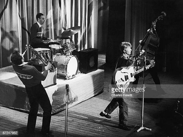 English pop idol Tommy Steele performs with his band the Steelemen 25th February 1957 They are Alan Stuart on tenor sax Alan Weighell on bass and Leo...