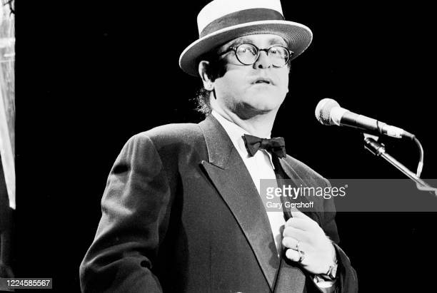 English Pop musician Elton John speaks onstage during the Third Annual Rock and Roll Hall of Fame Awards ceremony at the Waldorf Astoria Hotel, New...