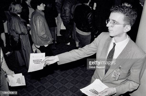 English Pop musician Richard Coles, of the group the Communards, hands out flyers on the Red Wedge Tour, Birmingham Odeon, Birmingham, 1/27/1986....
