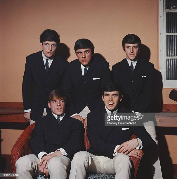 English pop rock group The Dave Clark Five circa 1965 Standing left to right singer Mike Smith drummer Dave Clark and bassist Rick Huxley Seated...