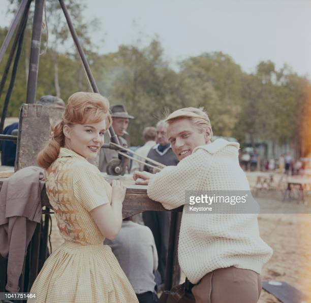 English pop singer Adam Faith and French actress MarieFrance on the set of the film 'What a Whopper' at Ruislip Lido London 1961
