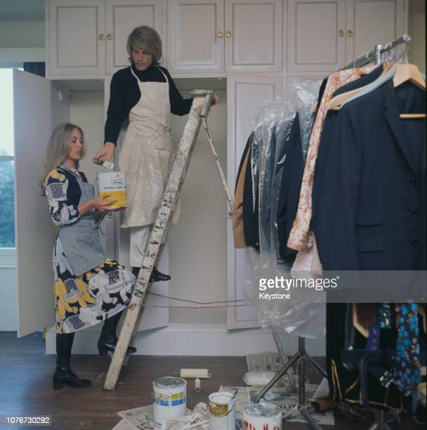 English pop singer Adam Faith decorating his home with his wife Jackie Irving UK circa 1970