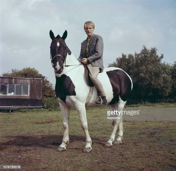 English pop singer Adam Faith riding a horse circa 1970