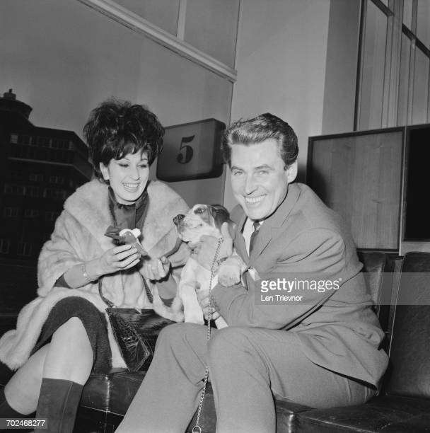 English pop singer Alma Cogan and popular music pianist Russ Conway at London Airport with a puppy UK 19th February 1964
