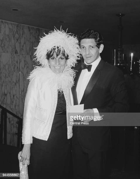 English pop singer Alma Cogan arrives at the Empire Theatre Leicester Square London with her fiancé Brian Morris for the gala charity premiere of the...