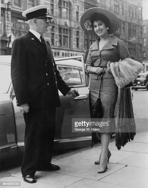 English pop singer Alma Cogan leaves her home in Kensington London for Royal Ascot wearing a bamboo picture hat and a mink stole 19th June 1956