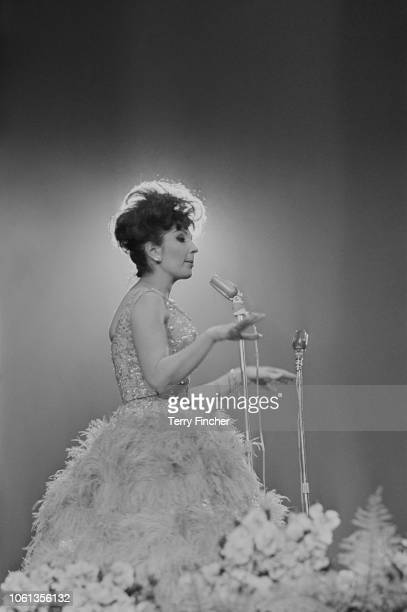 English pop singer Alma Cogan performing at the Daily Express Record Star Show Wembley's Empire Pool London UK 24th March 1963