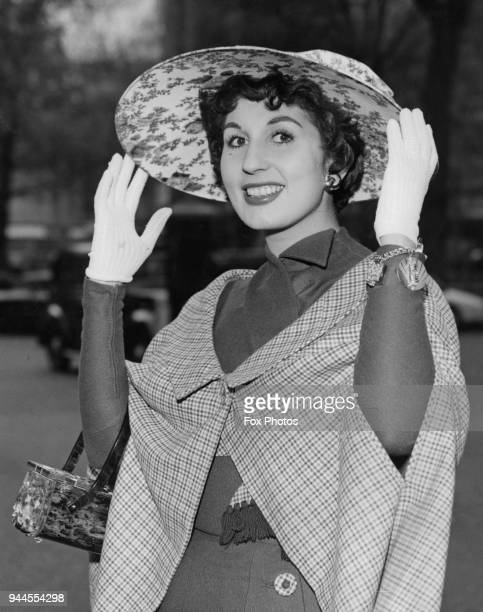 English pop singer Alma Cogan returns from a twoweek visit to the United States wearing an Easter bonnet 20th April 1957