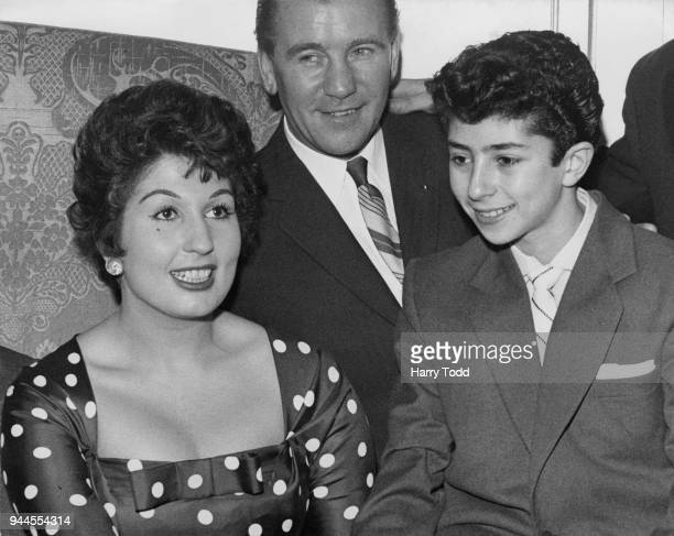 English pop singer Alma Cogan with 14yearold singer Laurie London at the Variety Club of Great Britain luncheon at the Dorchester Hotel in London...