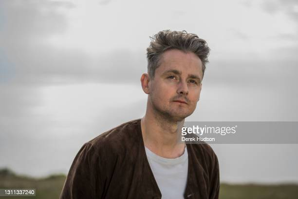 English pop singer and musician Tom Chaplin pictured during a photo session on a deserted road at Birling Gap, near Eastbourne, to promote his solo...