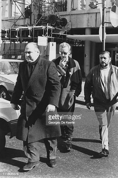 English pop singer Boy George is accompanied by bodyguards during a shopping trip in Camden London 26th March 1987