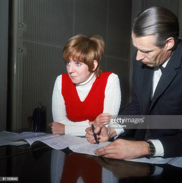 English pop singer Cilla Black in the studio with producer George Martin recording the title song to her first film 'Work is a Four Letter Word' 22nd...