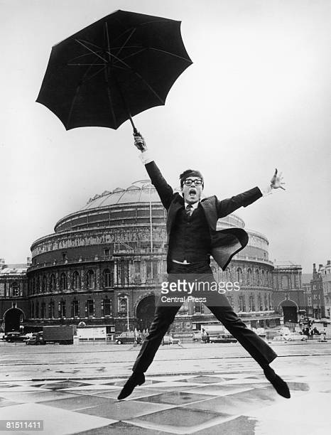 English pop singer Cliff Richard in a display of enthusiasm outside the Royal Albert Hall London where he is to represent the UK in the Eurovision...