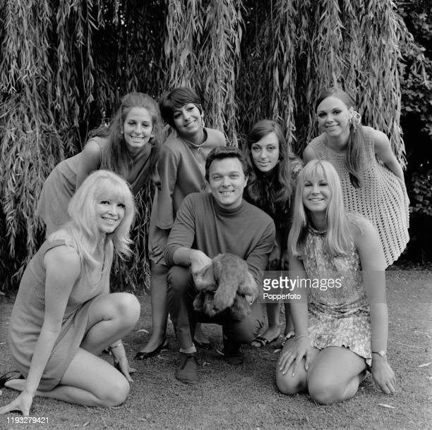 English pop singer Dickie Valentine posed with members of English dance troupe Pan's People in August 1967 Pan's People from left Babs Lord Dee Dee...