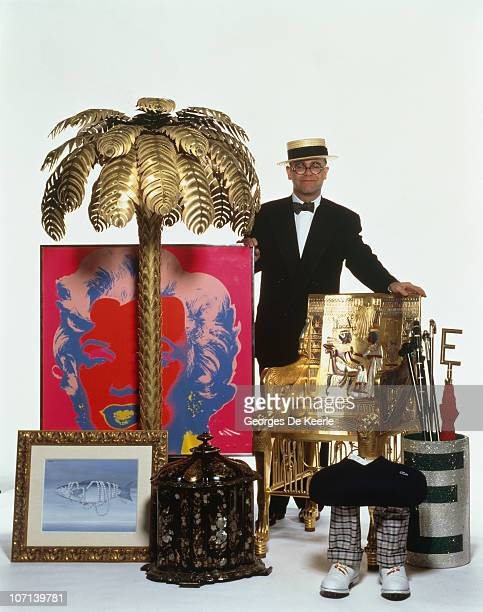 English pop singer Elton John with some of the items he will be putting up for auction at Sotheby's London 1988 Among the items are an Andy Warhol...