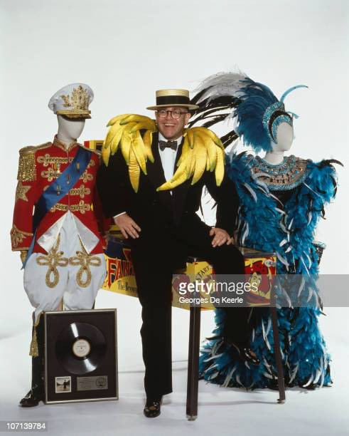 English pop singer Elton John with some of the items he will be putting up for auction at Sotheby's London 1988 Among the items are a platinum disc...