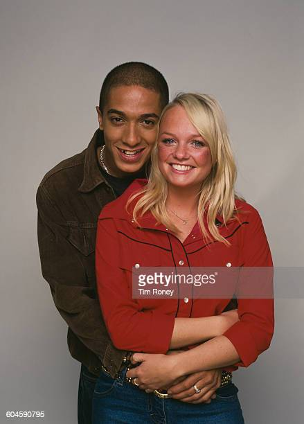 English pop singer Emma Bunton aka 'Baby Spice' of girl group The Spice Girls with her boyfriend R B singer Jade Jones circa 1990