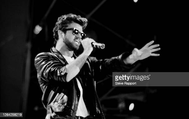 English Pop singer George Michael , of the group Wham, performs at Live Aid, Wembley Stadium, London, 7/13/1985.