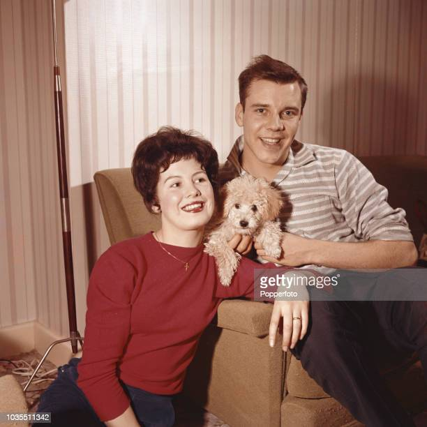 English pop singer Marty Wilde pictured with his wife Joyce and poodle dog at home in England in 1960