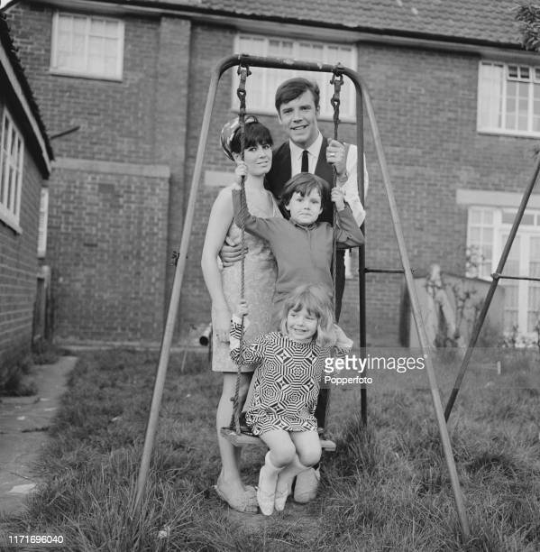 English pop singer Marty Wilde with his wife Joyce and children Ricky Wilde and Kim Wilde together on a swing in the garden of their home in May 1966