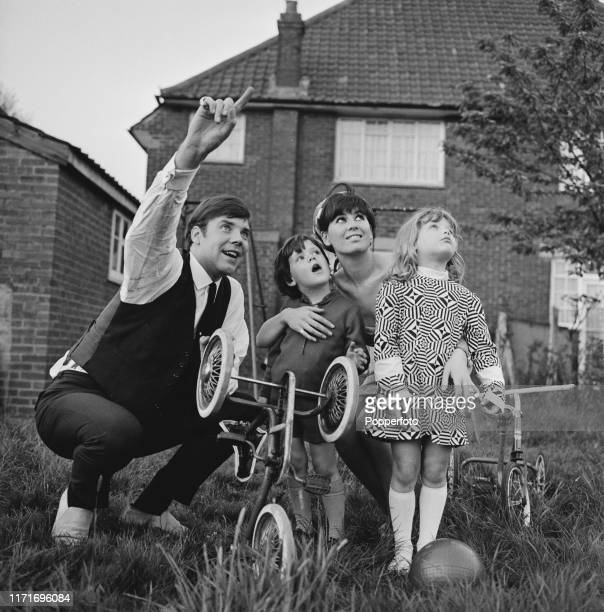 English pop singer Marty Wilde with his wife Joyce and children Ricky Wilde and Kim Wilde in the garden of their home in May 1966