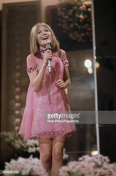 English pop singer Sandie Shaw performing the winning song, 'Puppet On A String', at the Eurovision Song Contest, at the Grosser Festsaal der Wiener...