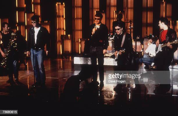 English pop ska band Madness performing on stage circa 1985 Left to right Lee Thompson Mike Barson Suggs Chris Foreman and Mark Bedford