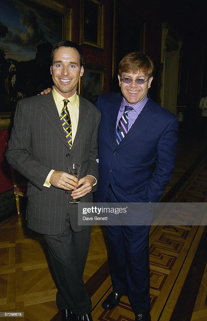 English pop star Elton John and his partner David Furnish attend Lord Linley's furniture launch at the Wallace Collection in London, 26th June 1997.