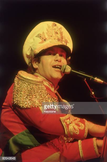 English pop star Elton John performs in a militarystyle costume with gold epaulettes at the Hammersmith Odeon 16th December 1982