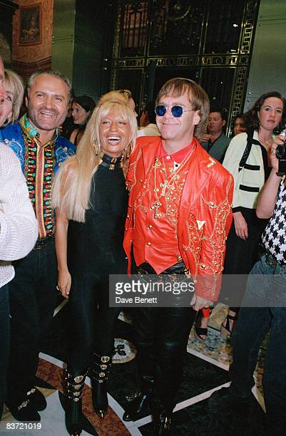 English pop star Elton John with Gianni and Donatella Versace at the opening of Versace's new store 28th May 1992