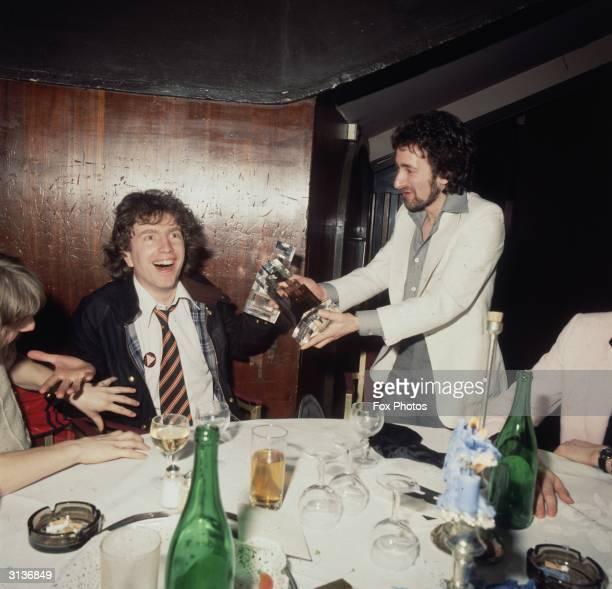 English pop star Tom Robinson at an awards dinner with Nicky Horne a Disc Jockey with Capital Radio