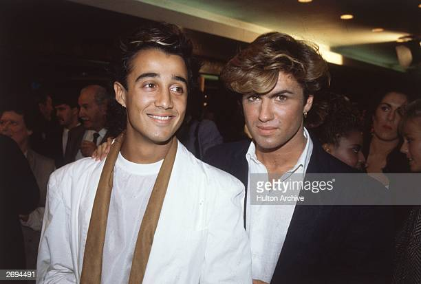English pop stars Andrew Ridgeley and George Michael of Wham at the film premiere of 'Dune'.