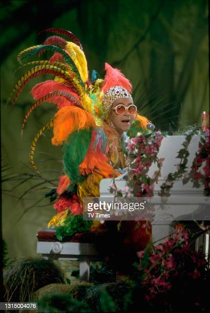 English pop/rock musician Elton John performing his song 'Crocodile Rock' on the set of The Muppet Show at Elstree Studios, Hertfordshire, circa...